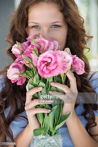 Portrait of a woman holding a bouquet of flowers