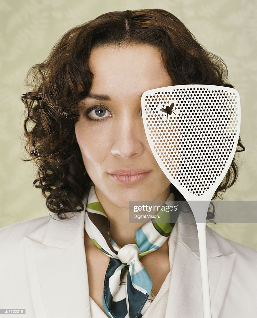 http://media.gettyimages.com/photos/portrait-of-a-woman-holding-a-fly-swatter-with-a-dead-fly-on-it-picture-iddv1760019?k=6&m=dv1760019&s=170667a&w=0&h=pX9adBBskKsNFgSAAjK2WFny0sYj7GVUYce5hDLuvUo=