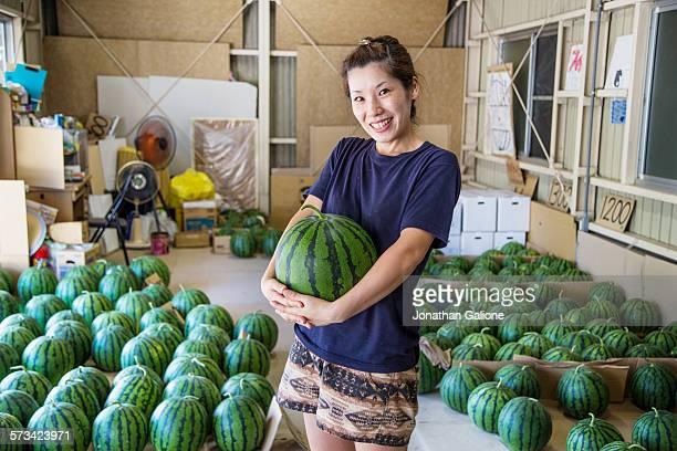 Portrait of a woman holding a watermelon