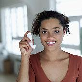 portrait of a woman holding an inhaler