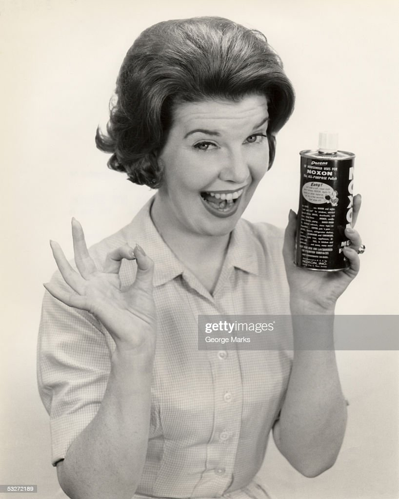 Portrait of a woman holding can of Noxon : Stock Photo
