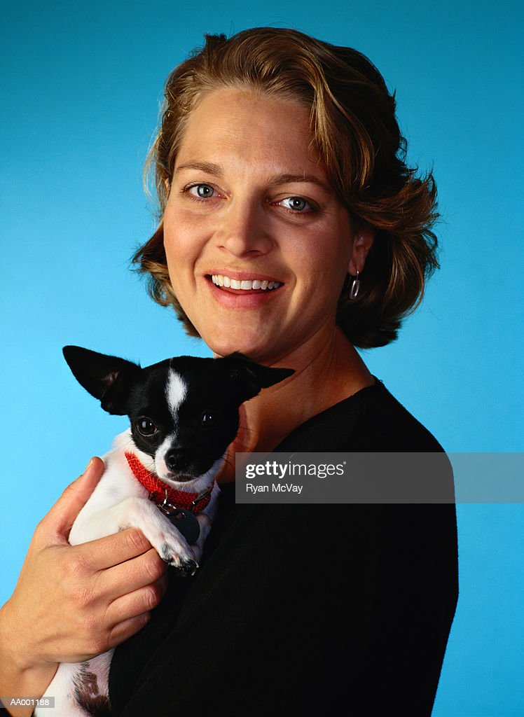Portrait of a Woman Holding Her Chihuahua : Stock Photo