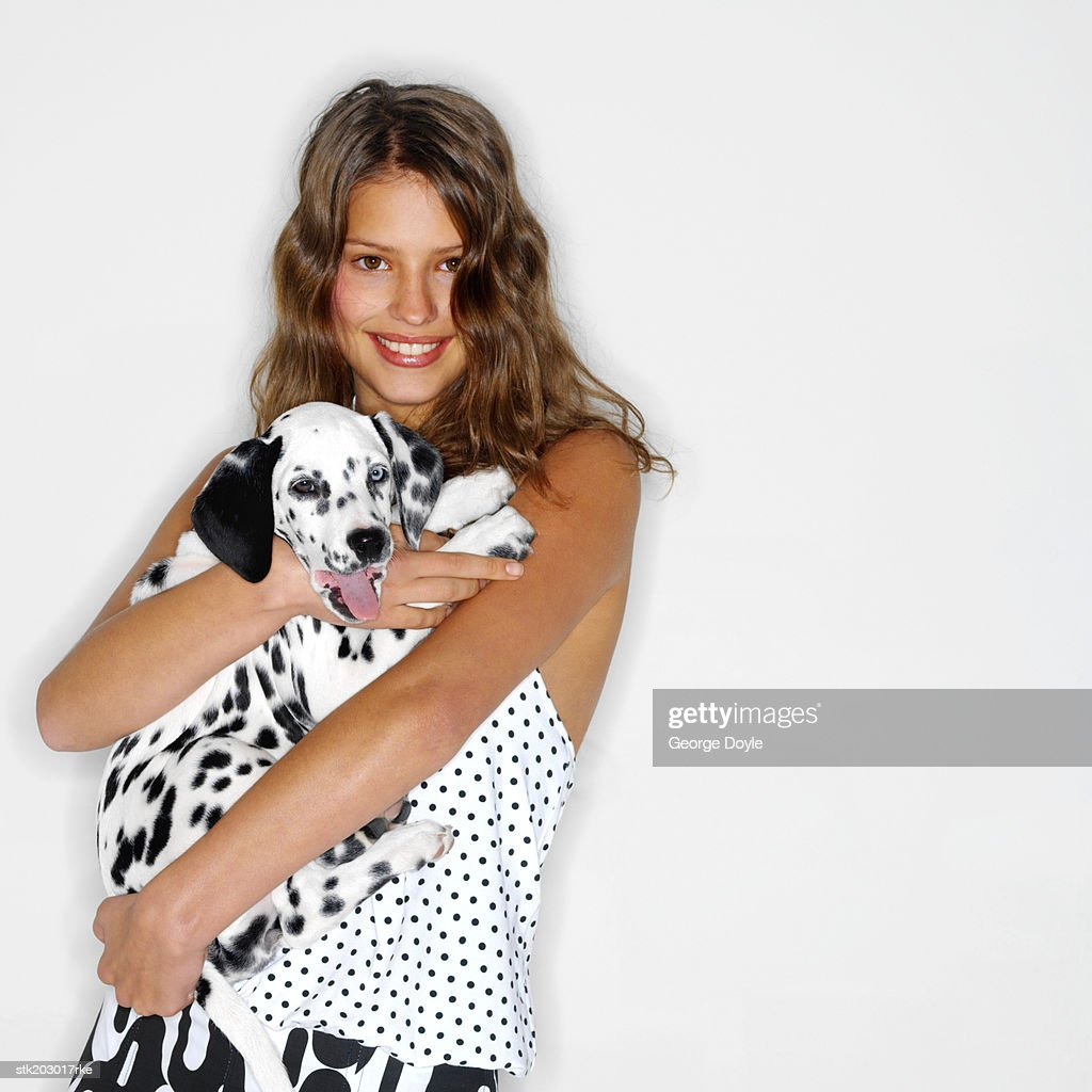 portrait of a woman hugging her Dalmatian dog : Stock Photo
