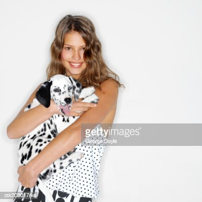 portrait of a woman hugging her Dalmatian dog