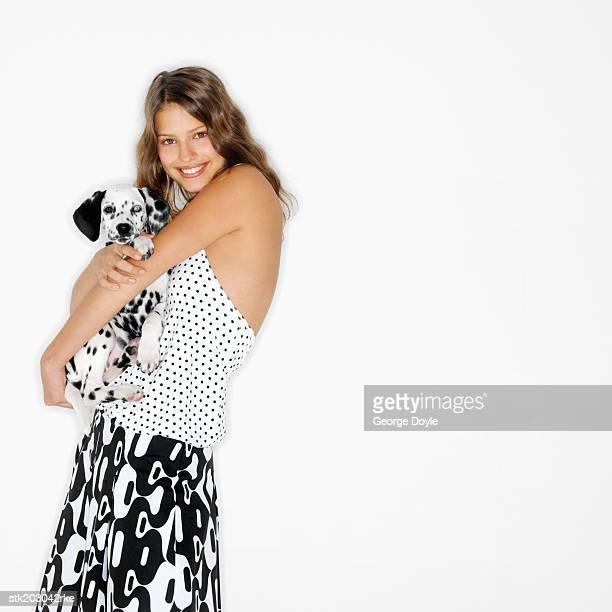 portrait of a woman hugging her Dalmatian dog