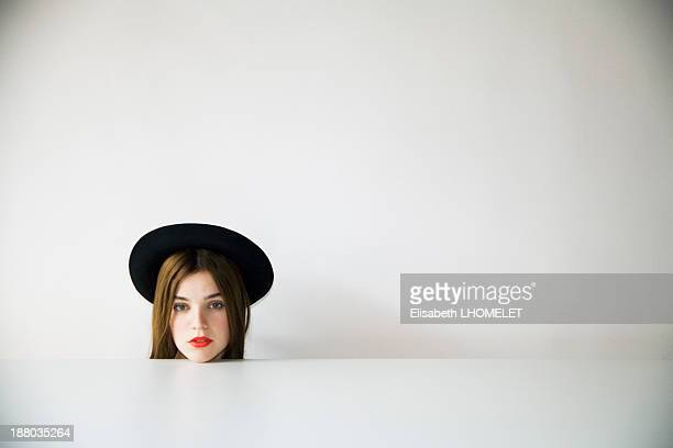 Portrait of a woman in a white room