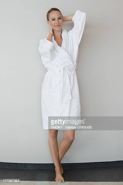 Portrait of a woman in bathrobe at spa