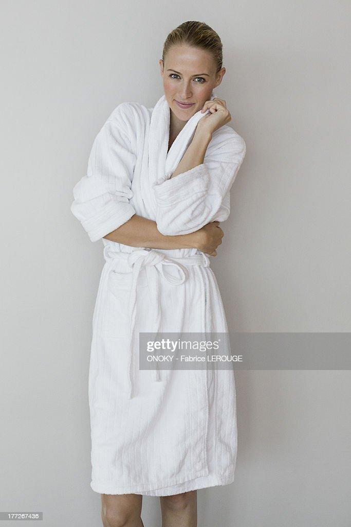Portrait of a woman in bathrobe at spa