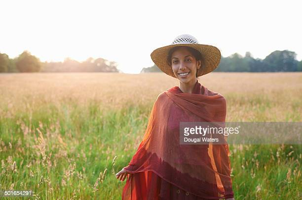 Portrait of a woman in meadow wearing shawl