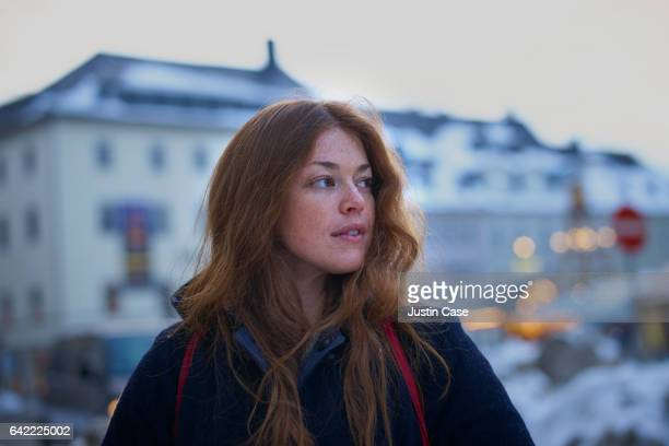 portrait of a woman in snow covered city