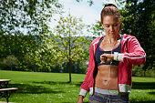 Portrait of a woman in sportswear checking an Apple Watch Sport taken on May 21 2015