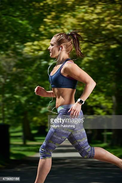 Portrait of a woman in sportswear running while modelling an Apple Watch Sport taken on May 21 2015