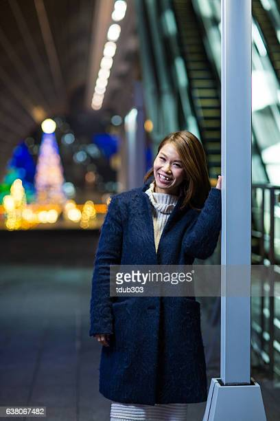 Portrait of a woman in the city at night