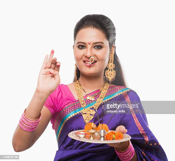 Portrait of a woman making a religious offerings on Gudi Padwa festival