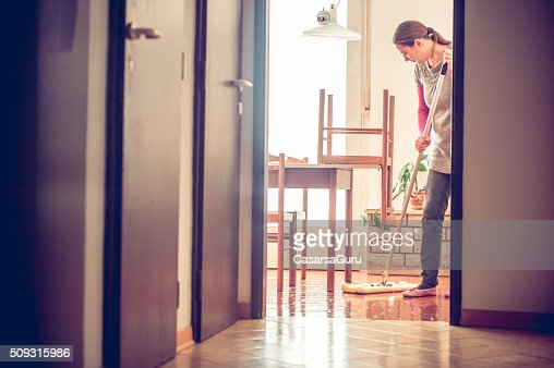 Portrait of a Woman Mopping Floor