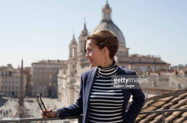 Portrait of a woman on a terrace overlooking Piazza Navona, Rome, Italy