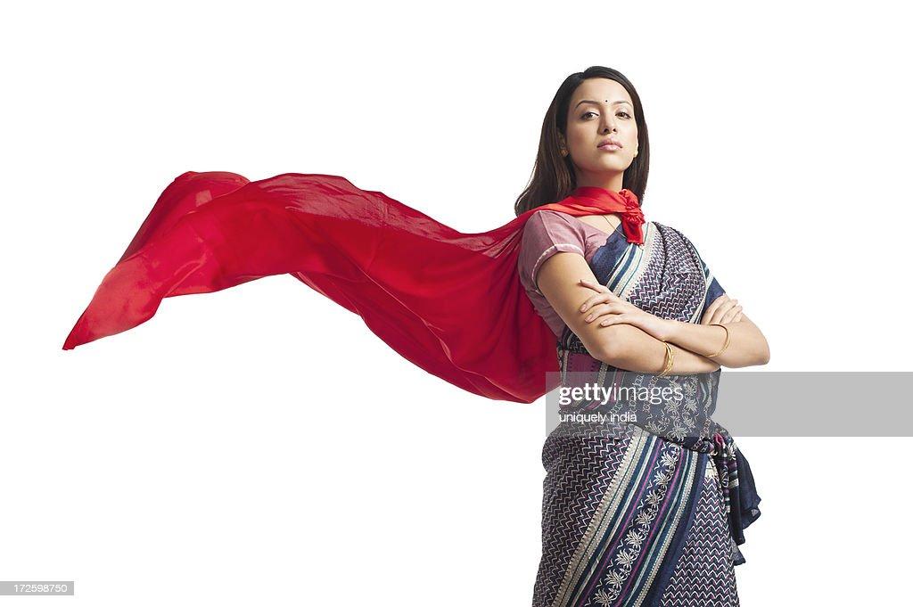 Portrait of a woman posing in superhero costume