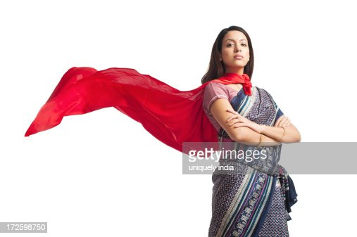 Portrait of a woman posing in superhero costume