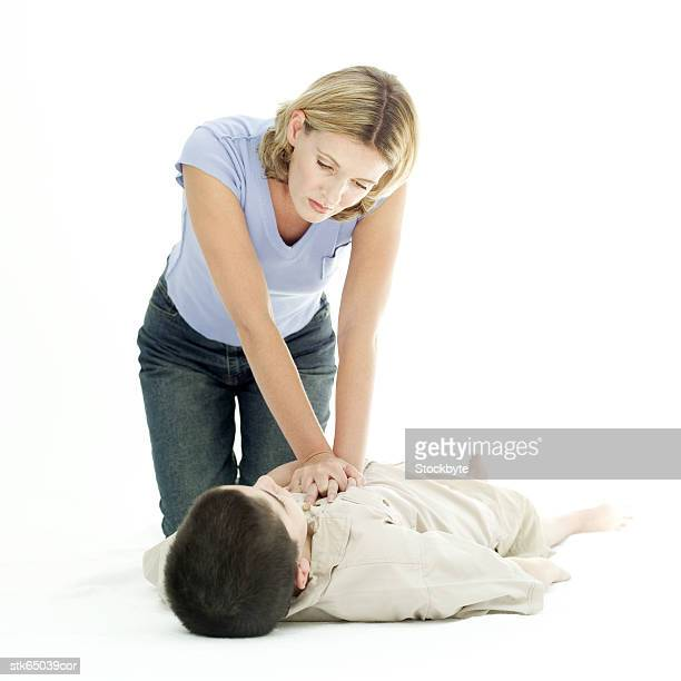 portrait of a woman resuscitating a young boy