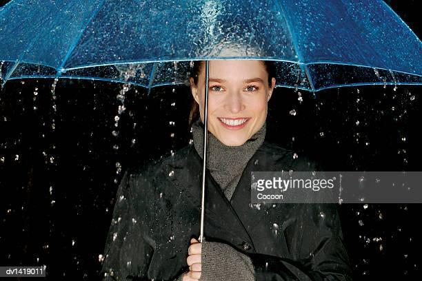 Portrait of a Woman Sheltering Under an Umbrella