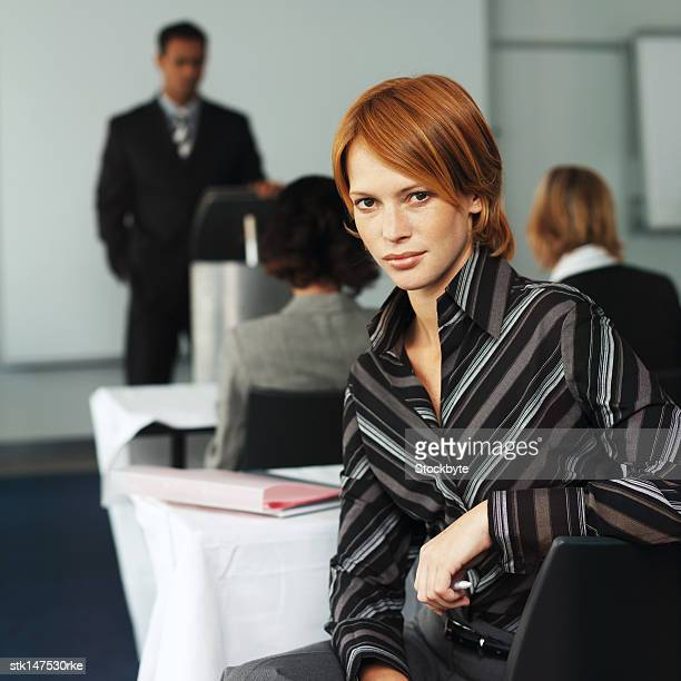 portrait of a woman sitting in a conference