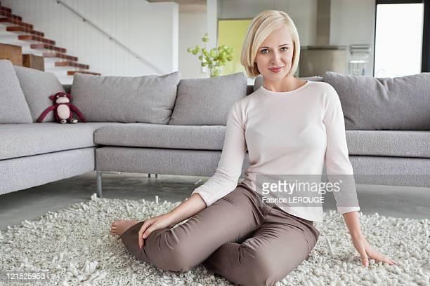 Portrait of a woman sitting on carpet