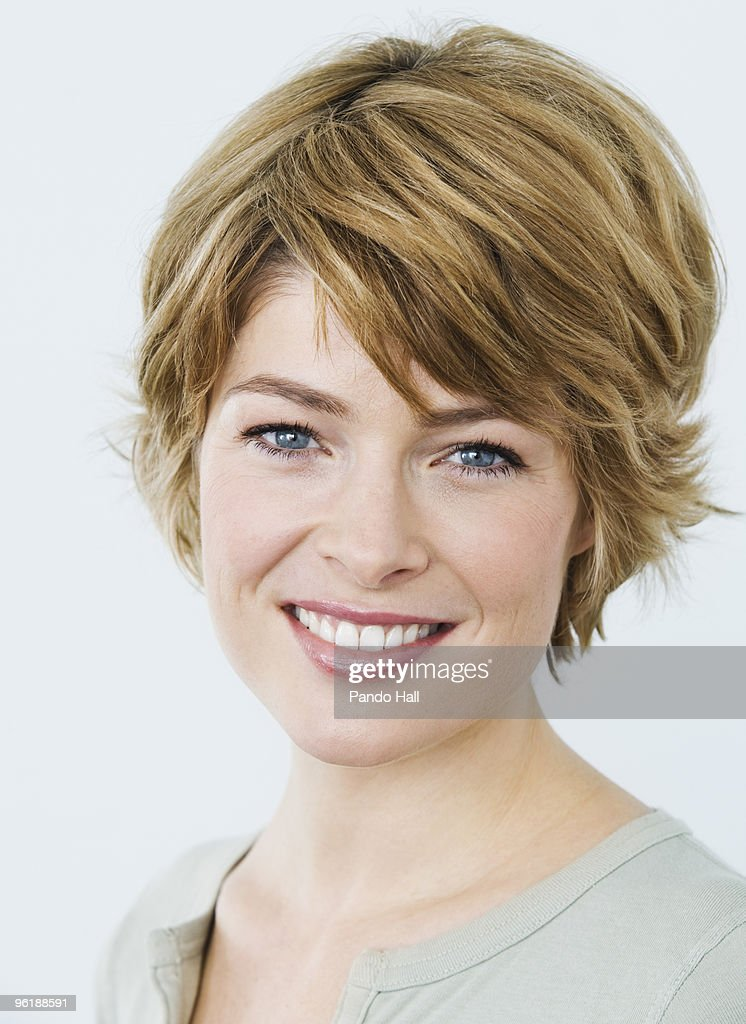 Portrait of a woman smiling, close-up : Stock Photo