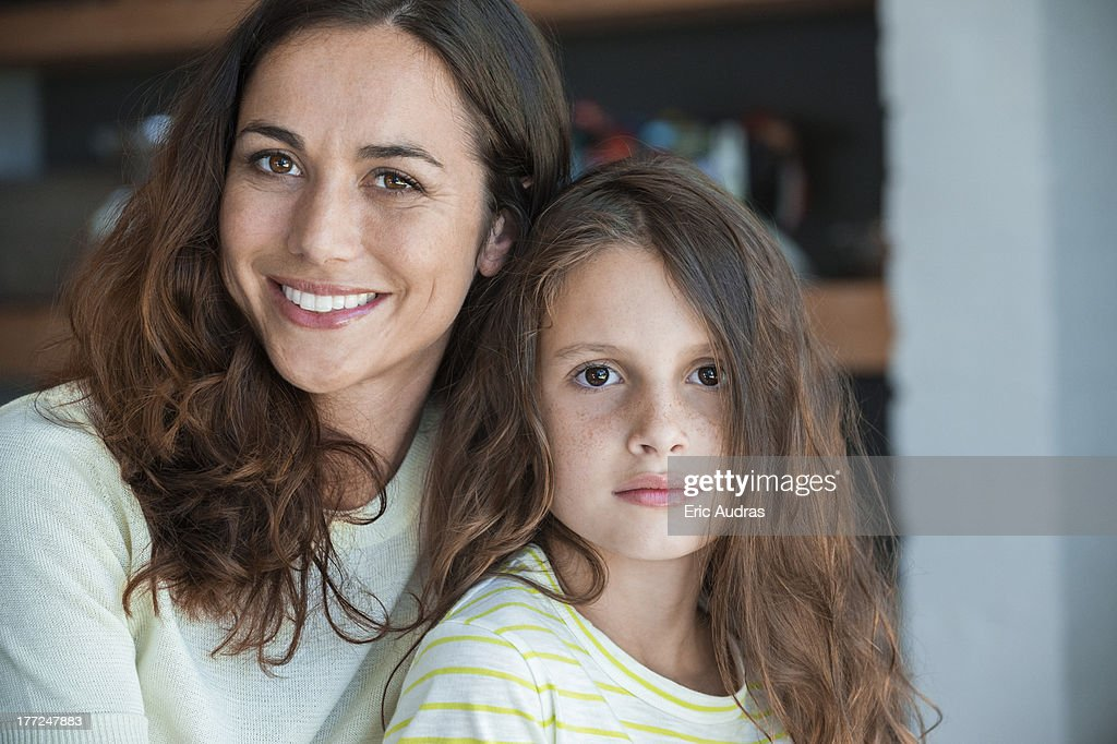 Portrait of a woman smiling with her daughter : Stock Photo