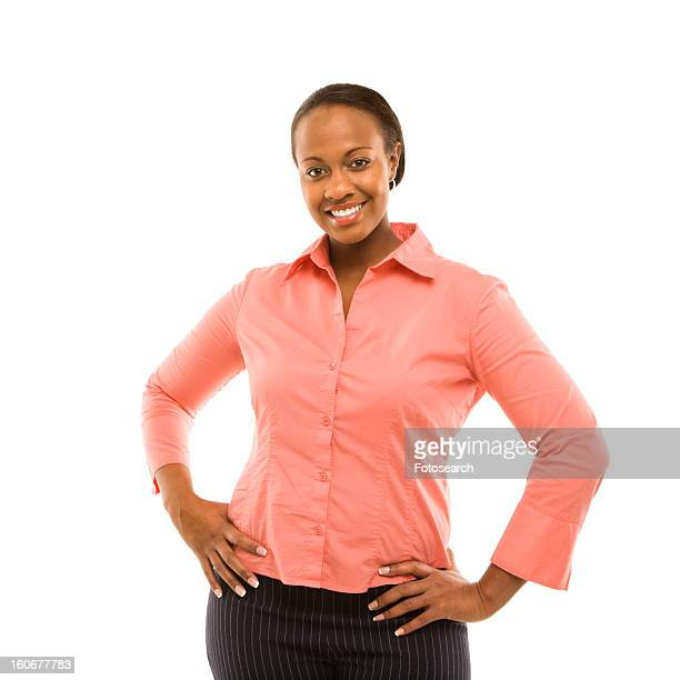 Portrait of a woman standing and smiling against white background