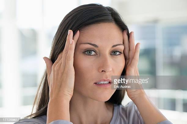 Portrait of a woman suffering from a headache