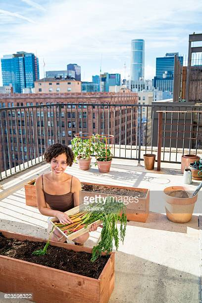 Portrait of a woman tending to her rooftop garden