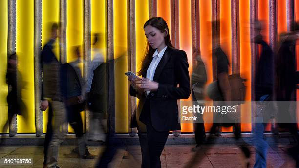 portrait of a woman texting in the crowd