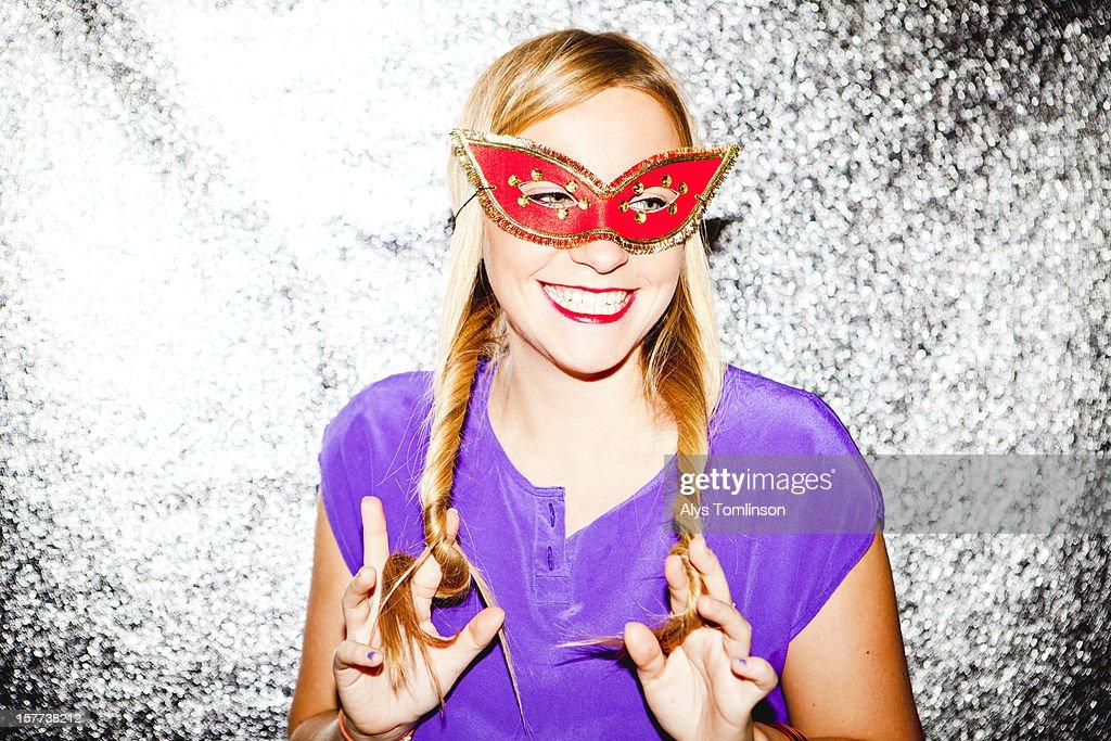 Portrait of a woman wearing a fancy dress mask : Stock Photo