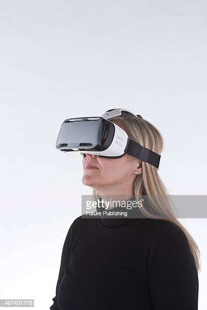 Portrait of a woman wearing a Samsung Gear VR headset taken on March 11 2015