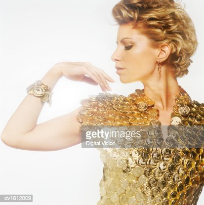 Portrait of a Woman Wearing a Shirt of Gold Coins : Stock Photo