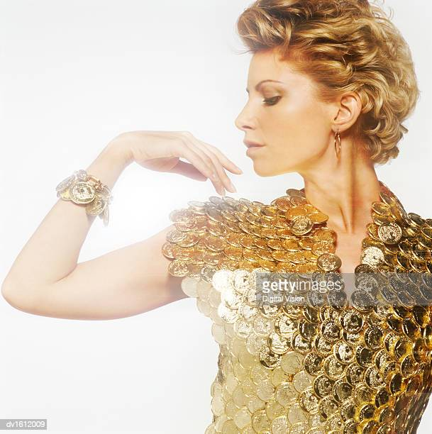 Portrait of a Woman Wearing a Shirt of Gold Coins
