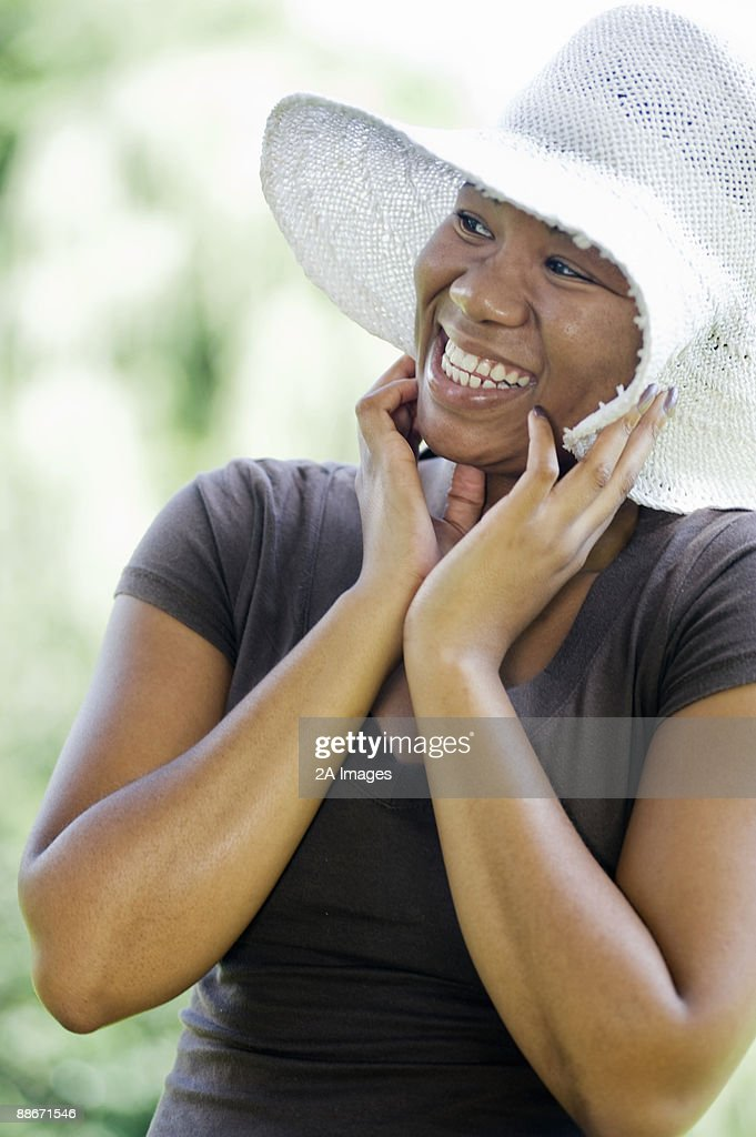 Portrait of a woman wearing a sun hat,  Johannesburg, Gauteng Province, South Africa : Stock Photo