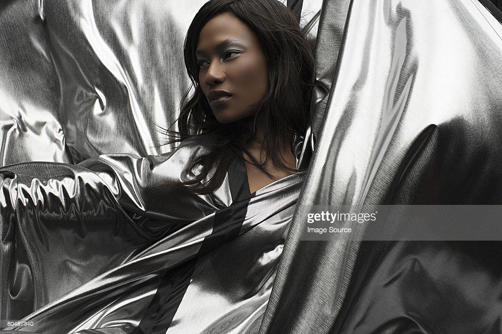 Portrait of a woman wearing silver dress