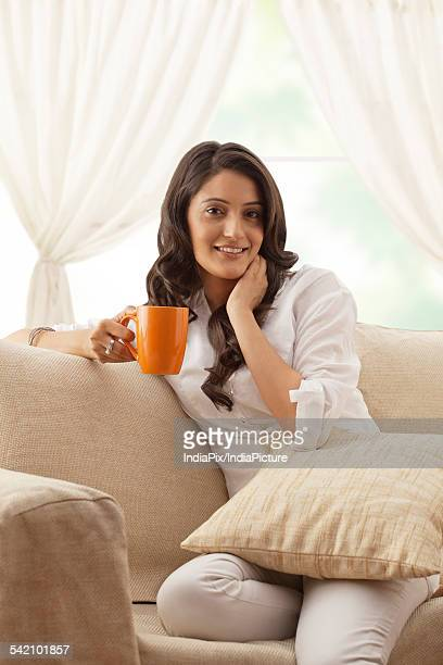 Portrait of a woman with a mug of tea