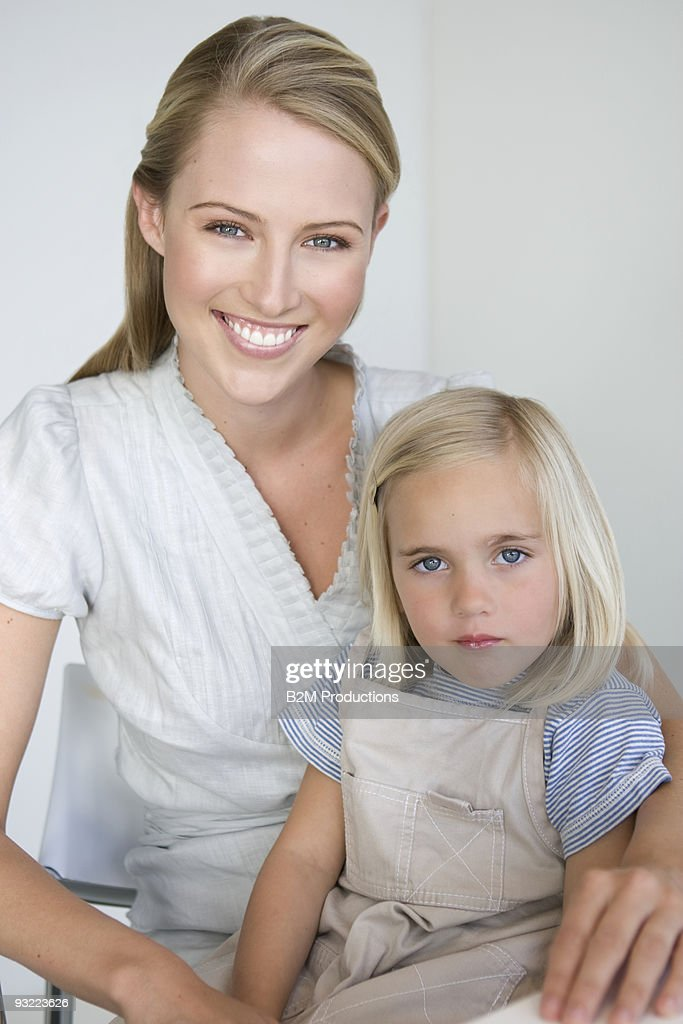 Portrait of a woman with daughter : Stock Photo