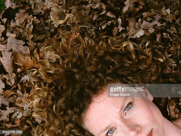 Portrait of a woman with dry leaves on her hair