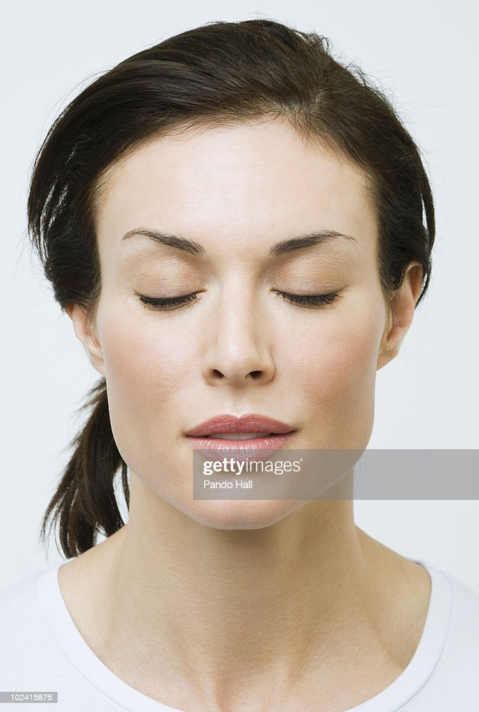 Portrait of a woman with eyes closed, close-up