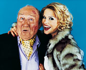 Portrait of a Woman with her Arm Around a Wealthy Senior Man