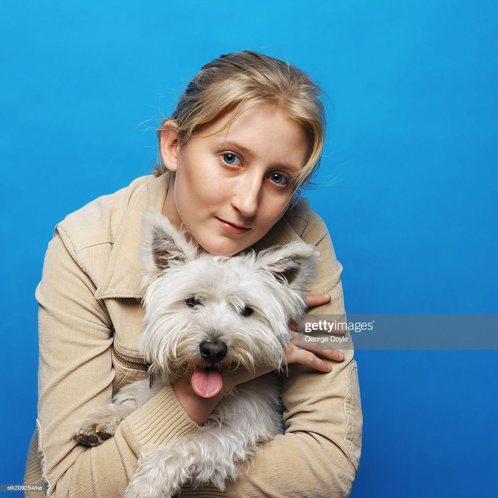 portrait of a woman with her west highland terrier dog : Stock Photo