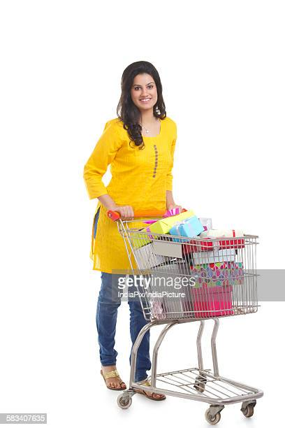Portrait of a woman with shopping cart