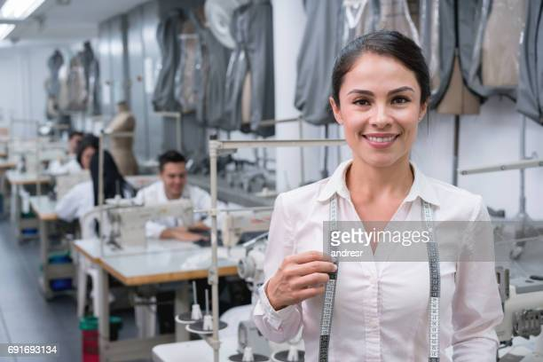 Portrait of a woman working at a clothing factory