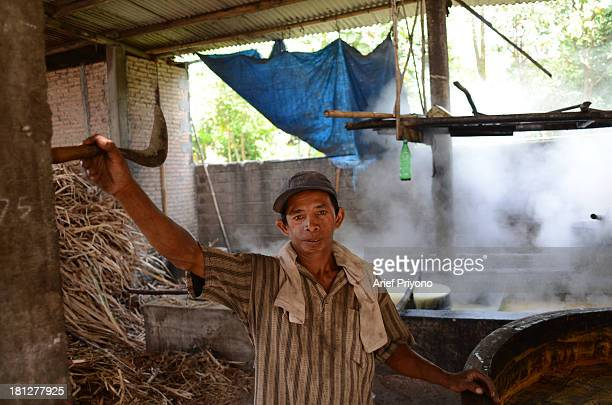 Portrait of a worker Joko in a small brown sugar factory in Slumbung village Most Indonesian people use brown sugar to sweeten foods and beverages...