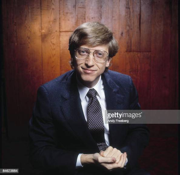 Portrait of a young Bill Gates cofounder of the software company Microsoft smiling as he leans forward towards the camera New York City 1984