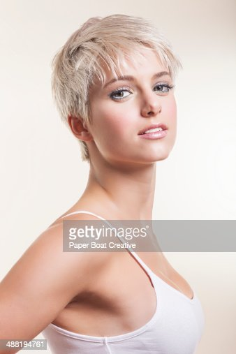 Portrait of a young blonde pixie haired girl : Stock Photo
