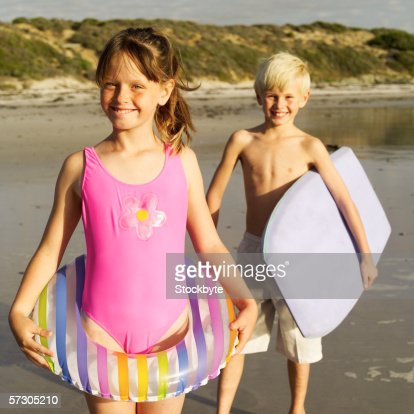 portrait of a young boy and a young girl with beach gear